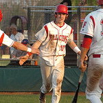 Firelands' #10 Tristan Clark gets congrats after crossing home plate.