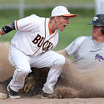 Keystone's Tyler Gullett steals second base as Buckeye's Robbie Nonamaker attempts to make the tag in the first inning. (RON SCHWANE / CT)