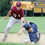 Wellington's Kevin Scott puts the tag down on Oberlin's Liam McMillin for the final out in the top of the seventh inning in the sectional game yesterday at Wellington High School. (CT photo  …