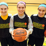 Morgan Dziak, left, Brianna Shagovac and Sydney Failing of Amherst basektball on Feb. 12. Steve Manheim