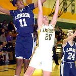 Lorain's #11 Alexandria Harris strips the ball from Amherst's #20 Sydney Falling