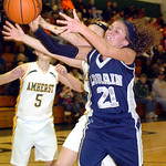 Lorain&#039;s #21 Destiny Wilson fights Amherst&#039;s #14 Mallory Sliman for the ball.