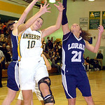 Amherst&#039;s #10 Brianna Shagovac fights Lorain&#039;s #24 Onyx Lopez and #21 Alexandria Harris for the rebound.