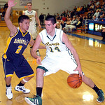 Amherst's #14 Marcus Schmitz works around North Ridgeville's #2 Anthony Nguyen.