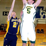 Amherst's #5 Griffin Weir shoots past North Ridgeville's #21 James Schwarzer.