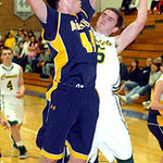 North Ridgeville's #44 Nate Lnal tries to block Amherst's #5 Griffin Weir.