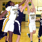 Amherst's #34 Brooke Wallace and #20 Sydney Failing fight Perkins' #12 Shannon Ebert for the ball.