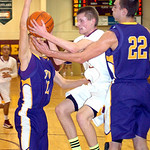 Avon Lake's #33 Seth Muck fights Avon's #10 Jack Pyle and #22 Matt Lawrence to get to the basket.