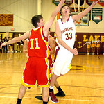 1-24-12 linda murphy</p> <p>AL&#039;s #33 Zach Scott tries to shoot past Brecksville&#039;s #11 Mark Chrzanowski
