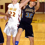 Avon Lake's #22 Maggie Heschel and Clearview's #32 Raquel Santana fight for the rebound.