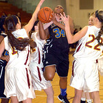 Avon Lake's #10 Kay Butrey, #12 Logan LeDuc and #22 Maggie Heschel block Clearview's #34 Angel Blakely's shot.