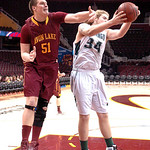 Avon Lake's #51 Ben Oxley tries to grab the rebound.