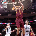 Avon Lake's #23 Jimmy Hessel leaps for a basket.