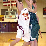 AL's #23 Collin Holmes shoots past Westlake's #44 Gavin Skelly.