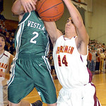 Westlake's #2 Bryan Mackenzie fight AL's #14 Dan Reichlin for the rebound.