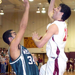 AL's #21 Ronnie Willoughby shoots past Westlake's #34 Andrew Guirguis.