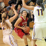 Shayla Middlebrooks of Elyria is defended by Avon's Sarah Sprecher, left, and Sierra Davidson. RAY RIEDEL/CHRONICLE