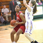 Elyria's Sybil Roseboro drives on a fast break as Avon sophomore Alyssa Douzos defends. RAY RIEDEL/CHRONICLE