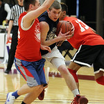 ANNA NORRIS/CHRONICLE<br/>Wellington&#039;s Dylan Kidd drives towards the basket against Midview&#039;s Grant Overy in the first half of the Lorain County Boys Legeza Cage Classic all-star game at Oberlin &#8230;