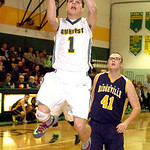 Amherst's Antonio Serrano gets past North Ridgeville's Nolan Freeman for the shot.LINDA MURPHY/CHRONICLE