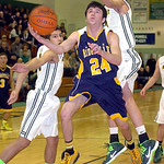 North Ridgeville's Jordan Montgomery shoots past Amherst's Casey McConhie, left, and Danny Fortney. LINDA MURPHY/CHRONICLE