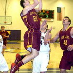 Avon Lake's Jason Hessel drives past Avon's Brian Kelly as teammate Brad Hamilton moves into rebound position.  LINDA MURPHY/CHRONICLE