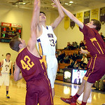 Avon's Will Ybarra shoots between Avon Lake's Brad Hamilton, left, and Seth Muck. LINDA MURPHY/CHRONICLE