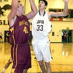 Avon Lake's Brad Hamilton tries to shoot past Avon's Will Ybarra. LINDA MURPHY/CHRONICLE