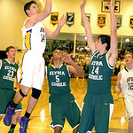 Avon's Zach Torbert shoots past Elyria Catholic's Ceeven Shelton and James Tirbaso. LINDA MURPHY/CHRONICLE