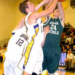 Avon's Johnny Peganoff and Austin Proudfit fight Elyria Catholic's James Tirbaso for the ball. LINDA MURPHY/CHRONICLE