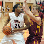 Elyria's AJ Johnson puts up a shot over Avon Lake's Brad Hamilton. STEVE MANHEIM/CHRONICLE