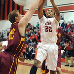 Avon Lake's Brad Hamilton blocks a shot by Elyria's Trenell Oliver. STEVE MANHEIM/CHRONICLE