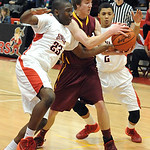 Avon Lake's Jason Hessel, middle, fights for a loose ball with Elyria's Antonio Blanton, left, and Bobby Russell. STEVE MANHEIM/CHRONICLE