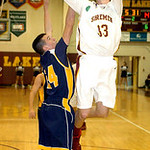 Avon Lake's Seth Muck shoots past North Ridgeville's Jordan Montgomery. LINDA MURPHY/CHRONICLE