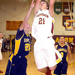 Avon Lake's Jason Hessel tries to shoot past North Ridgeville's Jordan Montgomery. LINDA MURPHY/CHRONICLE