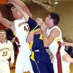 Avon Lake's Brad Hamilton, left, and Quinn Cantleberry fight North Ridgeville's Dennis Millgard for the ball. LINDA MURPHY/CHRONICLE