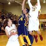 Avon Lake's Seth Muck shoots over North Ridgeville's Jordan Montgomery while teammate Jason Hessel gets in position for a rebound. LINDA MURPHY/CHRONICLE