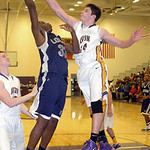 Avon's Zack Torbert blocks a shot. LINDA MURPHY/CHRONICLE