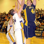 North Ridgeville's Nathan Colbert shoots over Avon's Jeffrey Laraway. LINDA MURPHY/CHRONICLE