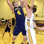 North Ridgeville's Nolan Freeman tries to shoot past Avon's Chris Maxwell. LINDA MURPHY/CHRONICLE