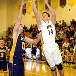 Avon's Zach Torbert shoots past North Ridgeville's Nolan Freeman. LINDA MURPHY/CHRONICLE