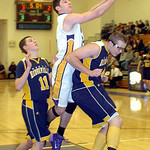 Avon's Zach Torbert drives past North Ridgeville's Chad Kisel, left, and Nolan Freeman. LINDA MURPHY/CHRONICLE