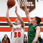 Buckeye junior Nick Willis puts up a shot past Columbia defender Brian Hershey during the first quarter. Photo by Aaron Josefczyk