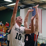 Medina's Evan Schreck scores over Mentor's Kyle McIntosh during the first quarter. (RON SCHWANE / GAZETTE)