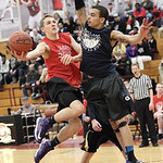 Jack Poyle of Avon leaps for two against Marcus Bailey of Oberlin in the Lorain County Boys All Stars Legeza Classic at Oberlin College. photo by Ray Riedel