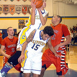 Clearview's Gerrell Williams collides with Jason Young and Brookside's Kelvin Jones as he goes up for a rebound. LINDA MURPHY/CHRONICLE