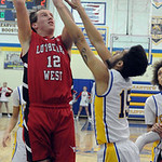 Lutheran West's Andrew O'Hara shoots over Clearview's Jason Young. STEVE MANHEIM/CHRONICLE