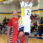 Clearview's Daimon Knowles drives past Brookside's Kelvin Jones for the basket. LINDA MURPHY/CHRONICLE