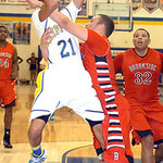 Brookside's Cameron Drew fouls Clearview's Daimon Knowles during a shot attempt. LINDA MURPHY/CHRONICLE