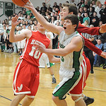 Columbia's Brian Hershey is fouled taking a shot by Hawken's Max Doody, rear, and Joe Dlugosz. STEVE MANHEIM/CHRONICLE